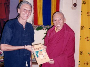 Jaman presenting Prof Rinpoche, Prime Minister of Tibetan government with seed saving book