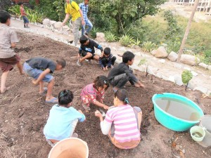 Engaging the childern with the work at Ramana's garden